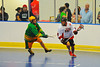 "Onondaga Redhawks Neal Powless (16) looking to make a play against the Newtown Golden Eagles in a Can-Am Senior ""B"" box lacrosse game at the Onondaga Nation Arena (Tsha'hon'nonyen'dakhwa') near Nedrow, New York on Saturday, May 12, 2012."
