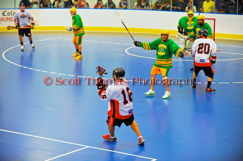 """Onondaga Redhawks Neal Powless (16) quarterbacking the power play against the Newtown Golden Eagles in a Can-Am Senior """"B"""" box lacrosse game at the Onondaga Nation Arena (Tsha'hon'nonyen'dakhwa') near Nedrow, New York on Saturday, May 12, 2012."""