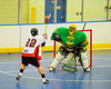 """Onondaga Redhawks James Cathers (22) tries to score against the Newtown Golden Eagles in a Can-Am Senior """"B"""" box lacrosse game at the Onondaga Nation Arena (Tsha'hon'nonyen'dakhwa') near Nedrow, New York on Saturday, May 12, 2012."""