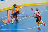 """Onondaga Redhawks Neal Powless (16) shoots and scores against the Six Nations Slash in round two of the Can-Am Senior """"B"""" playoffs at the Onondaga Nation Arena near Nedrow, New York on Friday, July 27, 2012. Redhawks won 17 to 5."""