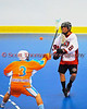 """Onondaga Redhawks A. J. Bucktooth (18) passes over Six Nations Slash defender Tyler Bomberry 93) in round two of the Can-Am Senior """"B"""" playoffs at the Onondaga Nation Arena near Nedrow, New York on Friday, July 27, 2012. Redhawks won 17 to 5."""