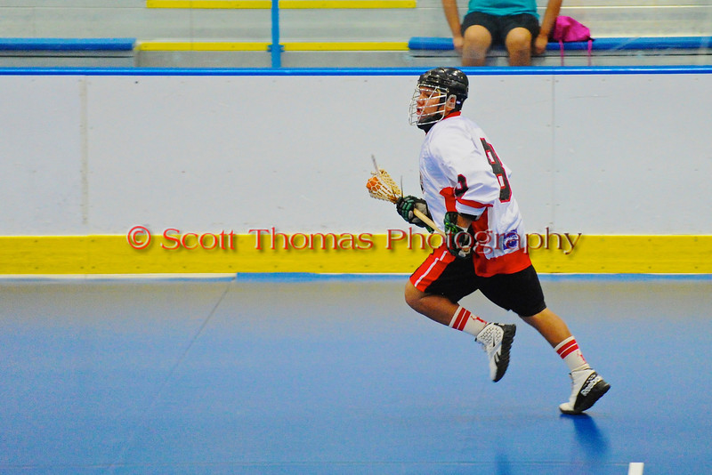 "Onondaga Redhawks Kevin Wilkerson (8) carrying the ball against the Six Nations Slash in game three of the second round of the Can-Am Senior ""B"" playoffs at the Onondaga Nation Arena near Nedrow, New York on Sunday, July 29, 2012. Redhawks won 15 to 6."