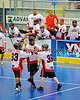 """Onondaga Redhawks playes Murray Stout Jr. (33) and Ron Cogan (9) congratulate Andy Spack (36) on his goal against the Six Nations Slash in round two of the Can-Am Senior """"B"""" playoffs at the Onondaga Nation Arena near Nedrow, New York on Friday, July 27, 2012. Redhawks won 17 to 5."""
