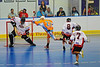 """Onondaga Redhawks goalie stops Six Nations Slash runner Jeff VanEvery using two sticks in round two of the Can-Am Senior """"B"""" playoffs at the Onondaga Nation Arena near Nedrow, New York on Friday, July 27, 2012. Redhawks won 17 to 5."""