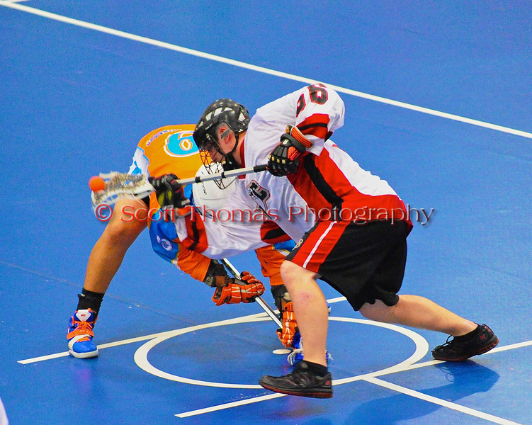 """Onondaga Redhawks Andy Spack (36) wins a face-off against the Six Nations Slash in round two of the Can-Am Senior """"B"""" playoffs at the Onondaga Nation Arena near Nedrow, New York on Friday, July 27, 2012. Redhawks won 17 to 5."""
