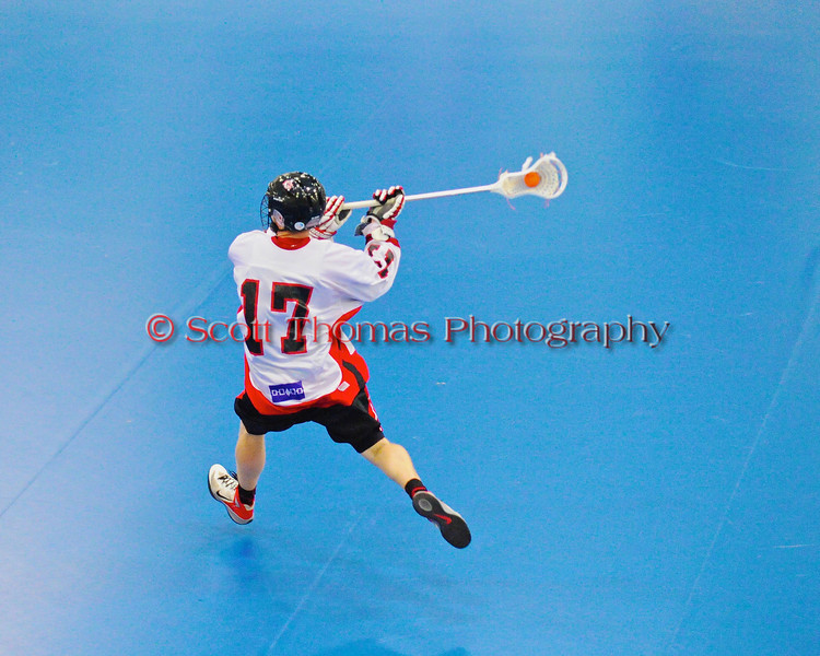 """Onondaga Redhawks Dan Rogers (17) gettng ready to take a shot against the Six Nations Slash in round two of the Can-Am Senior """"B"""" playoffs at the Onondaga Nation Arena near Nedrow, New York on Friday, July 27, 2012. Redhawks won 17 to 5."""