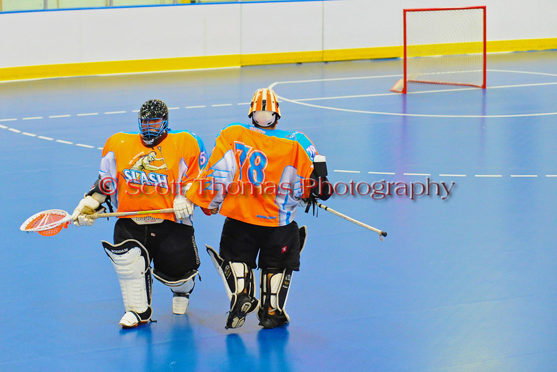 """Six Nations Slash goaltenders pass each other as Taseh Nanticoke (78) returns to the net replacing Ryan McNaughton (58) against the Onondaga Redhawks in round two of the Can-Am Senior """"B"""" playoffs at the Onondaga Nation Arena near Nedrow, New York on Friday, July 27, 2012. Redhawks won 17 to 5."""