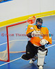"""Six Nations Slash goalie Ryan McNaughton (58) passes the ball against the Onondaga Redhawks in round two of the Can-Am Senior """"B"""" playoffs at the Onondaga Nation Arena near Nedrow, New York on Friday, July 27, 2012. Redhawks won 17 to 5."""
