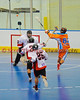 """Six Nations Slash Torrey VanEvery (88) passes over Onondaga Redhawks defenders in round two of the Can-Am Senior """"B"""" playoffs at the Onondaga Nation Arena near Nedrow, New York on Friday, July 27, 2012. Redhawks won 17 to 5."""