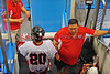 """Onondaga Redhawks Dustin Hill (20) greeted by his coaches before the third period against the Six Nations Slash in round two of the Can-Am Senior """"B"""" playoffs at the Onondaga Nation Arena near Nedrow, New York on Friday, July 27, 2012. Redhawks won 17 to 5."""