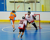 """Onondaga Redhawks goalie Ross Bucktooth (30) stops Six Nations Slash Kenny Aaron (61) in round two of the Can-Am Senior """"B"""" playoffs at the Onondaga Nation Arena near Nedrow, New York on Friday, July 27, 2012. Redhawks won 17 to 5."""