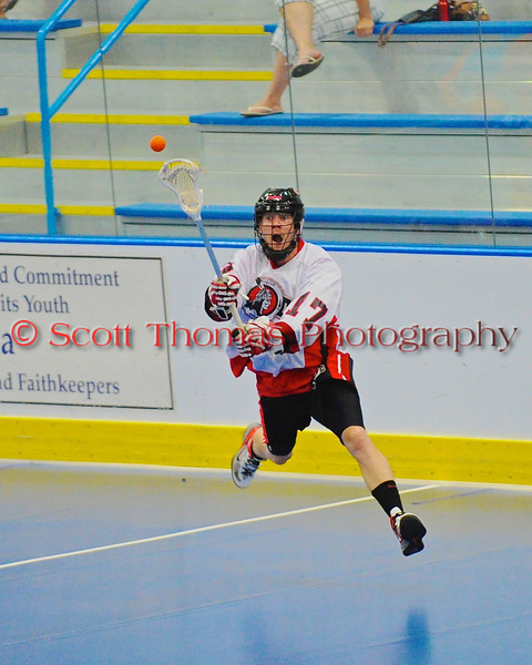 "Onondaga Redhawks Dan Rogers (17) makes a pass leading to a goal against the Six Nations Slash in game three of the second round of the Can-Am Senior ""B"" playoffs at the Onondaga Nation Arena near Nedrow, New York on Sunday, July 29, 2012. Redhawks won 15 to 6."