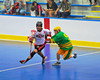 "Onondaga Redhawks Brett Bucktooth (66) sidesteps a Newtown Golden Eagles defender in the finals of the Can-Am Senior ""B"" Lacrosse league at the Onondaga Nation Arena near Nedrow, New York."