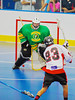 "Onondaga Redhawks Dwayne Porter (23) slips a shot past the Newtown Golden Eagles goalie in the finals of the Can-Am Senior ""B"" Lacrosse league at the Onondaga Nation Arena near Nedrow, New York."