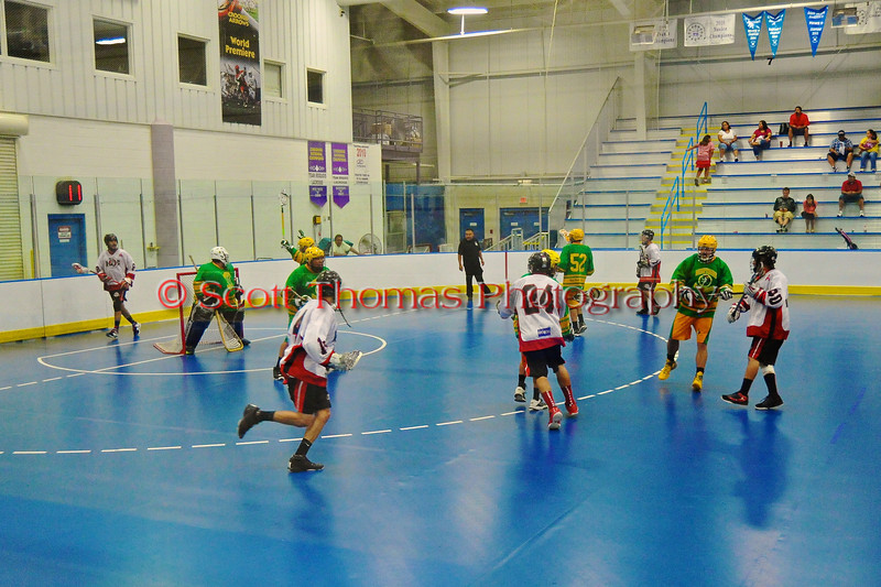 "Onondaga Redhawks holding the ball as time is about to expire against the Newtown Golden Eagles in the Can-Am Senior ""B"" Box Lacrosse finals at the Onondaga Nation Arena near Nedrow, New York."