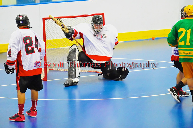 "Onondaga Redhawks goalie Ross Bucktooth (30) makes a save against Newtown Golden Eagles in the finals of the Can-Am Senior ""B"" Lacrosse league at the Onondaga Nation Arena near Nedrow, New York."