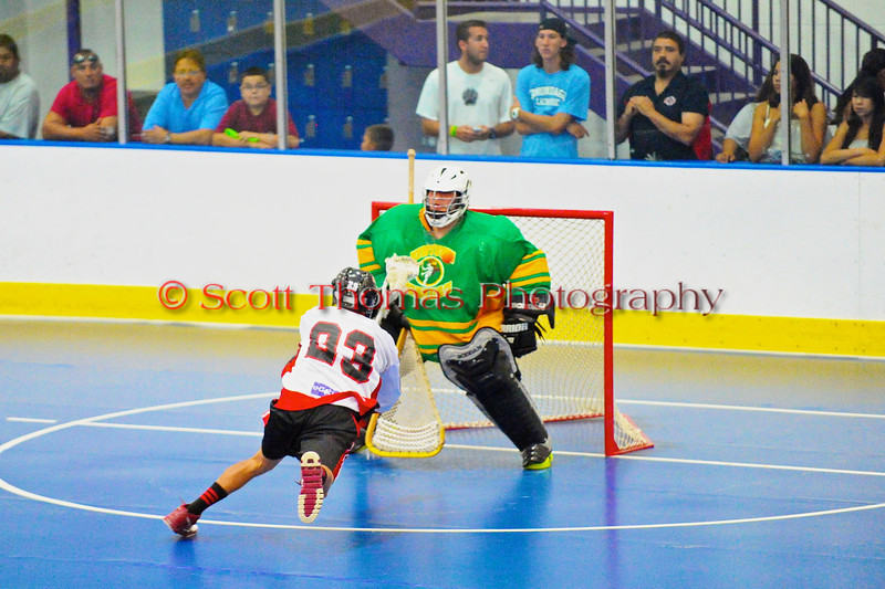 "Onondaga Redhawks Dwayne Porter (23) tries to score against the Newtown Golden Eagles in the finals of the Can-Am Senior ""B"" Lacrosse league at the Onondaga Nation Arena near Nedrow, New York."