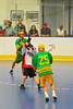 "Newtown Golden Eagles Tracy White (25) passes over an Onondaga Redhawks player in the Can-Am Senior ""B"" Box Lacrosse finals at the Onondaga Nation Arena near Nedrow, New York."