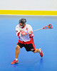 "Onondaga Redhawks Neal Powless (16) leans into a scoring shot against the Newtown Golden Eagles in the finals of the Can-Am Senior ""B"" Lacrosse league at the Onondaga Nation Arena near Nedrow, New York."