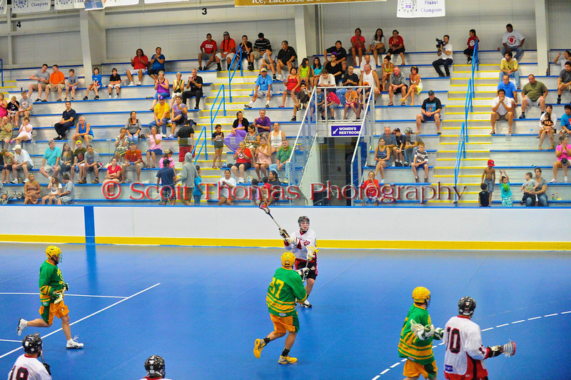 """Onondaga Redhawks James Cathers (22) looks to make a shot against the Newtown Golden Eagles in the finals of the Can-Am Senior """"B"""" Lacrosse league at the Onondaga Nation Arena near Nedrow, New York."""