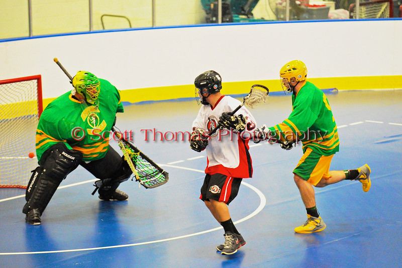 """Onondaga Redhawks Wade Bucktooth (19) scores against the Newtown Golden Eagles in the Can-Am Senior """"B"""" Box Lacrosse finals at the Onondaga Nation Arena near Nedrow, New York."""
