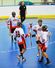 "Onondaga Redhawks players congratulate Brett Bucktooth (66) for his first period goal against the Newtown Golden Eagles in the finals of the Can-Am Senior ""B"" Lacrosse league at the Onondaga Nation Arena near Nedrow, New York."