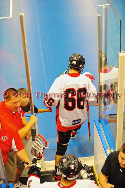 """Onondaga Redhawks Brett Bucktooth (66) before the playoff games against the Newtown Golden Eagles in the Can-Am Senior """"B"""" Box Lacrosse finals at the Onondaga Nation Arena near Nedrow, New York."""
