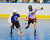 """Onondaga Redhawks Tyler Hill (14) fighs for a loose ball against the Niagara Hawks in Can-Am Senior """"B"""" playoff game at the Onondaga Nation Arena near Nedrow, New York on Saturday, July 20, 2011. Onondaga won 12-2."""