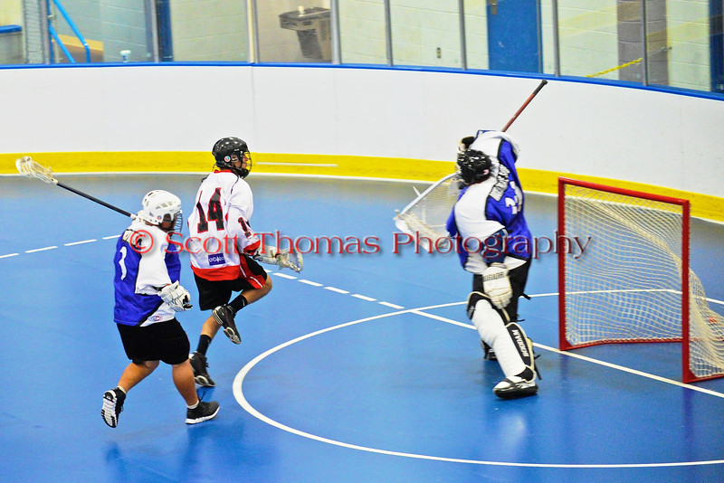 "Onondaga Redhawks Tyler Hill (14) scores against the Niagara Hawks goalie Findley Wilson (39) in Can-Am Senior ""B"" playoff game at the Onondaga Nation Arena near Nedrow, New York on Saturday, July 20, 2011. Onondaga won 12-2."
