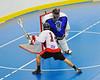 "Onondaga Redhawks Tyler Hill (14) puts the ball past Niagara Hawks goalie Findley Wilson (39) in Can-Am Senior ""B"" playoff game at the Onondaga Nation Arena near Nedrow, New York on Saturday, July 20, 2011. Onondaga won 12-2."