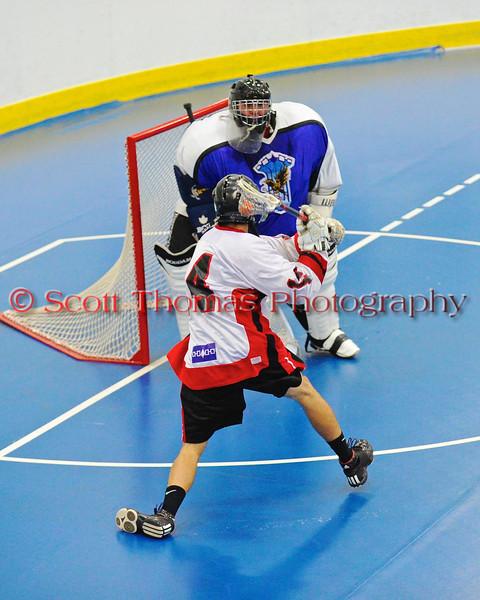"Onondaga Redhawks Tyler Hill (14) looking to score against the Niagara Hawks in Can-Am Senior ""B"" playoff game at the Onondaga Nation Arena near Nedrow, New York on Saturday, July 20, 2011. Onondaga won 12-2."