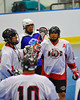 "Onondaga Redhawks players congratulating Brett Bucktooth (66) after he scored against the Niagara Hawks in Can-Am Senior ""B"" playoff game at the Onondaga Nation Arena near Nedrow, New York on Saturday, July 20, 2011. Onondaga won 12-2."