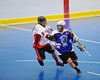 "Onondaga Redhawks David Stout (24) checking a Niagara Hawks player in Can-Am Senior ""B"" playoff game at the Onondaga Nation Arena near Nedrow, New York on Saturday, July 20, 2011. Onondaga won 12-2."