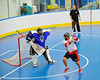 """Onondaga Redhawks Neal Powless (16) goes behind the back to score against the Niagara Hawks in Can-Am Senior """"B"""" playoff game at the Onondaga Nation Arena near Nedrow, New York on Saturday, July 20, 2011. Onondaga won 12-2."""