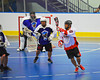 """Onondaga Redhawks Neal Powless (16) makes a pass leading to a goal against the Niagara Hawks in Can-Am Senior """"B"""" playoff game at the Onondaga Nation Arena near Nedrow, New York on Saturday, July 20, 2011. Onondaga won 12-2."""