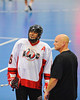 """Onondaga Redhawks alternate captain Neal Powless (16) talking with an offiicial at the Can-Am Senior """"B"""" playoff game against the Niagara Hawks at the Onondaga Nation Arena near Nedrow, New York on Saturday, July 20, 2011. Onondaga won 12-2."""