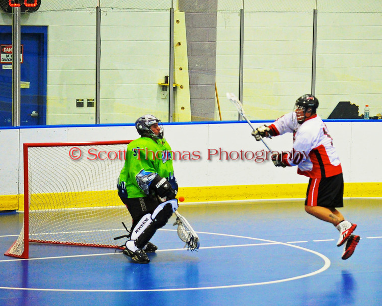 "Onondaga Redhawks Pete Benedict (10) in close to the Rochester Greywolves goal in Can-Am Senior ""B"" Box Lacrosse at the Onondaga Nation Arena near Nedrow, New York on Saturday, April 28, 2012."
