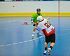 """Onondaga Redhawks James Cathers (22) fires a shot on goal against the Rochester Greywolves in Can-Am Senior """"B"""" Box Lacrosse at the Onondaga Nation Arena near Nedrow, New York on Saturday, April 28, 2012."""