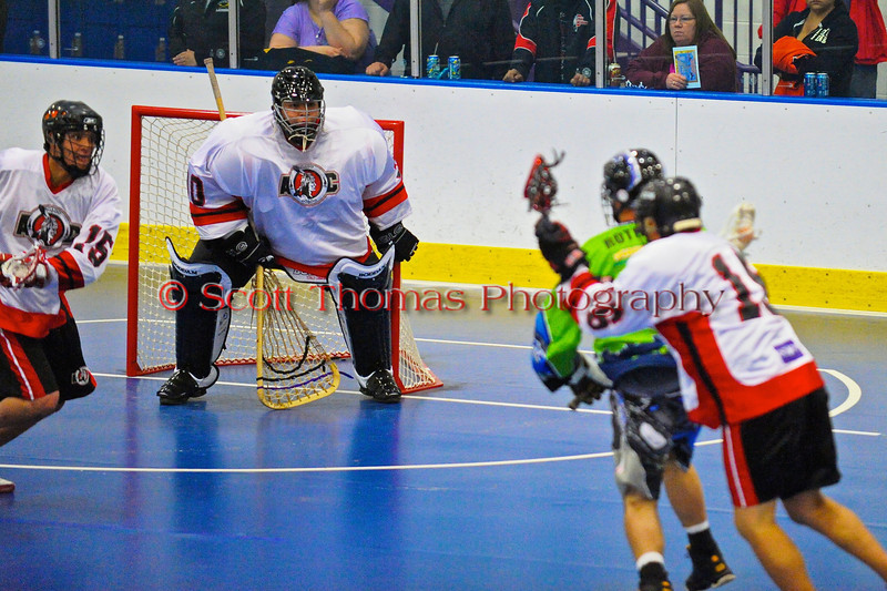 "Onondaga Redhawks Ross Bucktooth (30) in a game against the Rochester Greywolves in Can-Am Senior ""B"" Box Lacrosse at the Onondaga Nation Arena near Nedrow, New York on Saturday, April 28, 2012."