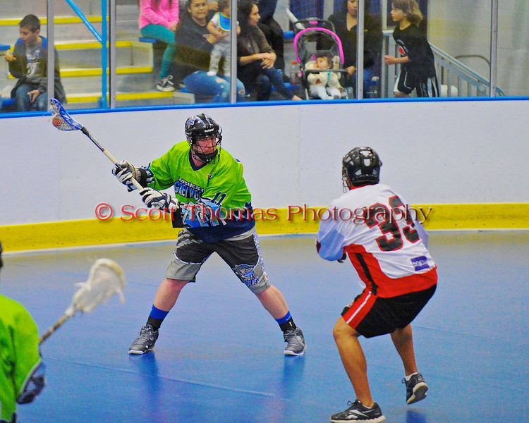 """Onondaga Redhawks Murray Stout Jr. (33) looking to stop the shot by a Rochester Greywolves player in Can-Am Senior """"B"""" Box Lacrosse at the Onondaga Nation Arena near Nedrow, New York on Saturday, April 28, 2012."""
