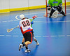 "Onondaga Redhawks James Cathers (22) firing a shot at the Rochester Greywolves goal in Can-Am Senior ""B"" Box Lacrosse at the Onondaga Nation Arena near Nedrow, New York on Saturday, April 28, 2012."