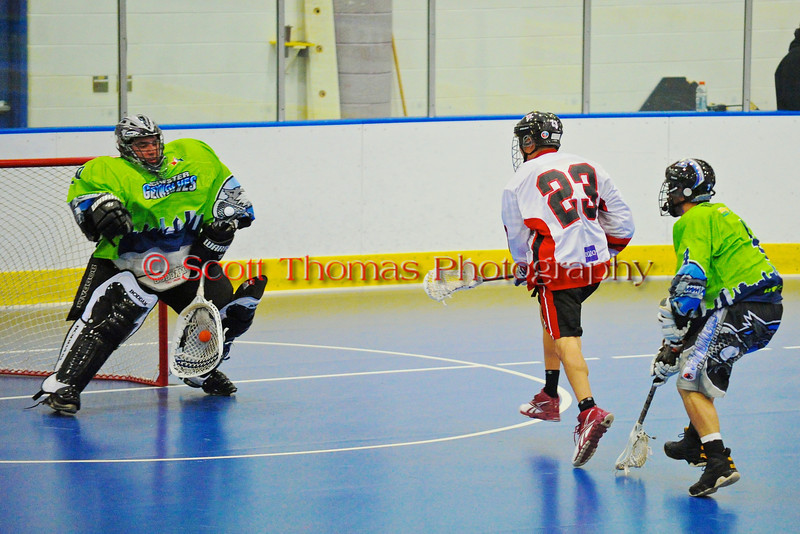 """Onondaga Redhawks Dwyane Porter (23) has his shot stopped by the Rochester Greywolves goalie in Can-Am Senior """"B"""" Box Lacrosse at the Onondaga Nation Arena near Nedrow, New York on Saturday, April 28, 2012."""
