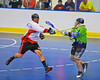"Onondaga Redhawks Ron Cogan (9) checks a Rochester Greywolves player in Can-Am Senior ""B"" Box Lacrosse at the Onondaga Nation Arena near Nedrow, New York on Saturday, April 28, 2012."