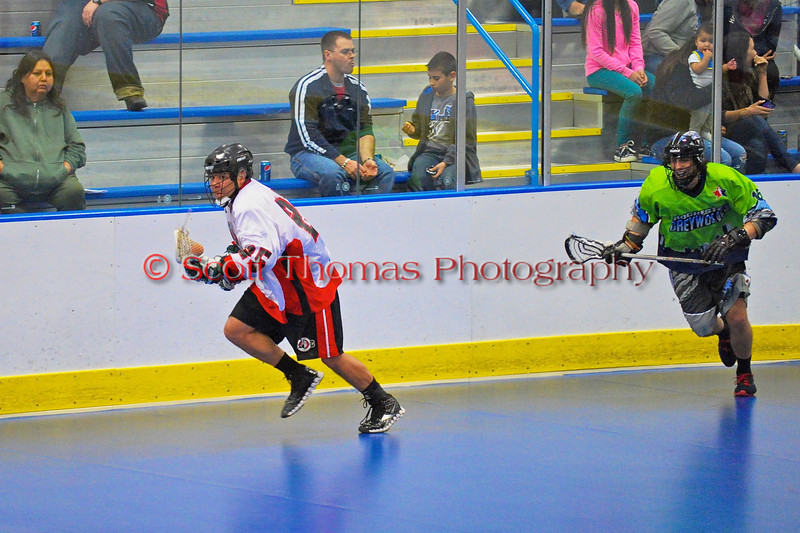 """Onondaga Redhawks """"Junior"""" Bucktooth (25) heading out of his end against the Rochester Greywolves in Can-Am Senior """"B"""" Box Lacrosse at the Onondaga Nation Arena near Nedrow, New York on Saturday, April 28, 2012."""