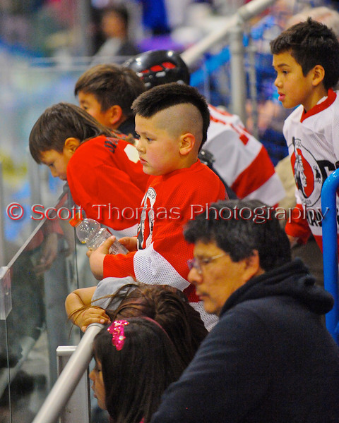 """Onondaga Redhawks young fans watching them play the Rochester Greywolves in Can-Am Senior """"B"""" Box Lacrosse at the Onondaga Nation Arena near Nedrow, New York on Saturday, April 28, 2012."""