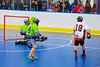 """Onondaga Redhawks A.J. Bucktooth (18) scores against  the Rochester Greywolves in Can-Am Senior """"B"""" Box Lacrosse at the Onondaga Nation Arena near Nedrow, New York on Saturday, April 28, 2012."""