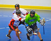 "Onondaga Redhawks Murray Stout Jr. (33) checks a Rochester Greywolves player in Can-Am Senior ""B"" Box Lacrosse at the Onondaga Nation Arena near Nedrow, New York on Saturday, April 28, 2012."