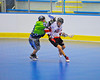 "Onondaga Redhawks player is checked by a Rochester Greywolves defender in Can-Am Senior ""B"" Box Lacrosse at the Onondaga Nation Arena near Nedrow, New York on Saturday, April 28, 2012."