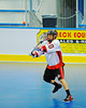 """Onondaga Redhawks Dustin Hill (20) passing to a teammate against the Rochester Greywolves in Can-Am Senior """"B"""" Box Lacrosse at the Onondaga Nation Arena near Nedrow, New York on Saturday, April 28, 2012."""