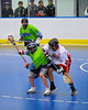 "Onondaga Redhawks ""Junior"" Bucktooth (25) checks a Rochester Greywolves player in Can-Am Senior ""B"" Box Lacrosse at the Onondaga Nation Arena near Nedrow, New York on Saturday, April 28, 2012."